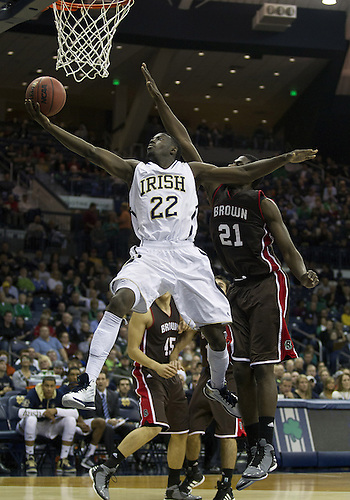 December 08, 2012:  Notre Dame guard Jerian Grant (22) goes up for a shot as Brown forward Cedric Kuakumensah (21) defends during NCAA Basketball game action between the Notre Dame Fighting Irish and the Brown Bears at Purcell Pavilion at the Joyce Center in South Bend, Indiana.  Notre Dame defeated Brown 84-57.