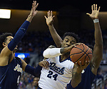 Nevada forward Jordan Caroline (24) tries to get a                          shot off against Akron in the first half of an NCAA college basketball game in Reno, Nev., Saturday, Dec. 22, 2018. (AP Photo/Tom R. Smedes)