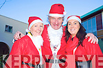 Killarney mayor Michael Gleeson pictured with Peig Fleming and Catriona O'Callaghan at the Santa Fun Run in Killarney on Saturday...