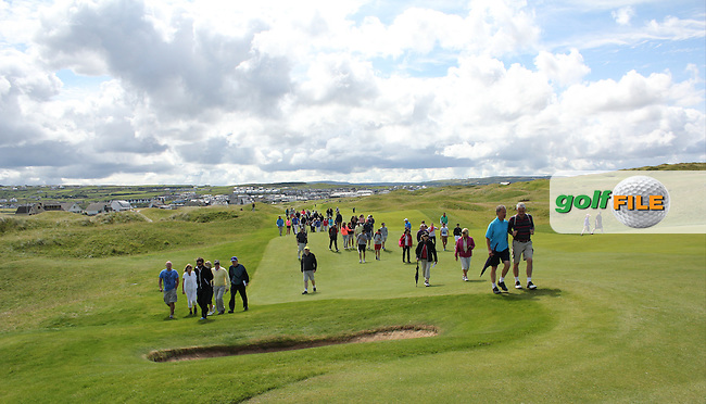 The crowd starting to walk up the 15th fairway during Matchplay Round 3 of the South of Ireland Amateur Open Championship at LaHinch Golf Club on Saturday 25th July 2015.<br /> Picture:  Golffile | TJ Caffrey