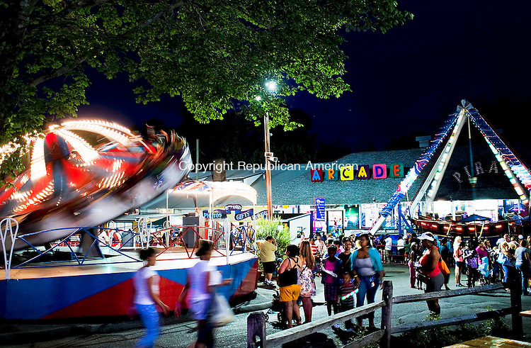 Middlebury, CT- 03 July 2015-070315CM14-  ****Country Life Only Please!!!***  ----  A crowd of people walk through Quassy Amusement Park as the Trabant spins around at in Middlebury on Friday night.   Christopher Massa Republican-American