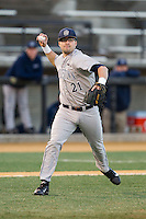 Georgetown Hoyas third baseman Eric Webber (21) makes a throw to first base against the Wake Forest Demon Deacons at Wake Forest Baseball Park on February 16, 2014 in Winston-Salem, North Carolina.  The Demon Deacons defeated the Hoyas 3-2.  (Brian Westerholt/Four Seam Images)