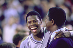 02 APR 1984:  Georgetown coach John Thompson (R) and center Patrick Ewing (33) after the NCAA Men's National Basketball Final Four championship game held in Seattle, WA Kingdome. Georgetown defeated Houston 84-75 for the title. Ewing was named MVP for the tournament. Photo Copyright Rich Clarkson/NCAA Photos.SI CD 1650-07