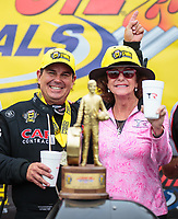 Aug 19, 2018; Brainerd, MN, USA; NHRA top fuel driver Billy Torrence (left) celebrates with wife Kay Torrence after winning the Lucas Oil Nationals at Brainerd International Raceway. Mandatory Credit: Mark J. Rebilas-USA TODAY Sports