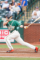 Justin Bohn (14) of the Greensboro Grasshoppers follows through on his swing against the Hagerstown Suns at NewBridge Bank Park on May 20, 2014 in Greensboro, North Carolina.  The Grasshoppers defeated the Suns 5-4. (Brian Westerholt/Four Seam Images)