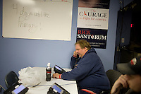 Volunteers make calls to gather support for former senator Rick Santorum at Santorum's New Hampshire campaign headquarters in Bedford, New Hampshire, on Jan. 7, 2012.  Santorum is seeking the 2012 Republican presidential nomination.