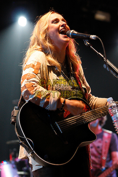 MELISSA ETHERIDGE .Performs at Hyde Park Calling - Day 2, London, England, UK, 26th June 2010..live music gig on stage festival concert.half length microphone singing  playing guitar country brown beige jacket shirt .CAP/MAR.©Martin Harris/Capital Pictures.