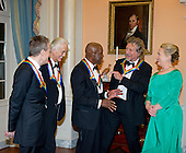 John Paul Jones, Jimmy Page, Buddy Guy and Robert Plant, four of the seven recipients of the 2012 Kennedy Center Honors, share some thoughts as United States Secretary of State Hillary Rodham Clinton looks on as they prepare to pose for a photo following a dinner hosted by the Secretary at the U.S. Department of State in Washington, D.C. on Saturday, December 1, 2012.  The 2012 honorees are Buddy Guy, actor Dustin Hoffman, late-night host David Letterman, dancer Natalia Makarova, and the British rock band Led Zeppelin (Robert Plant, Jimmy Page, and John Paul Jones)..Credit: Ron Sachs / CNP