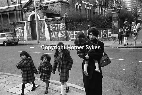 Chiswick Women Aid Shelter for Battered Women. Richmond  London England 1975. Mothers and their children who are staying in the hosel walking to local shops.