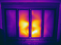 A Thermogram of fireplace.  The different colors represent different temperatures on the object. The lightest colors are the hottest temperatures, while the darker colors represent a cooler temperature.  Thermography uses special cameras that can detect light in the far-infrared range of the electromagnetic spectrum (900?14,000 nanometers or 0.9?14 µm) and creates an  image of the objects temperature..
