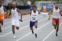 NWA Democrat-Gazette/ANDY SHUPE<br /> LSU's Jaron Flournoy (center) falls as he celebrates at the finish as he competes Saturday, May 11, 2019, in the 4x100-meter relay during the SEC Outdoor Track and Field Championships at John McDonnell Field in Fayetteville. Visit nwadg.com/photos to see more photographs from the meet.