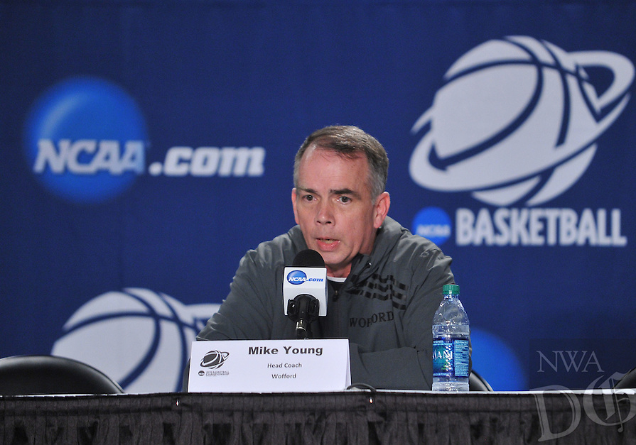 NWA Democrat-Gazette/Michael Woods --03/15/2015--w@NWAMICHAELW... Wofford head coach Mike Young answers questions during a press conference Wednesday evening at Jacksonville Veterans Memorial Arena in Jacksonville, Florida.