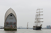 London, UK. 7 September 2014. Pictured: the tall ships Thalassa (at the front) and Loth Lorien passing the Thames Barrier. Tall ships travelling between Woolwich and Maritime Greenwich on the River Thames. The Royal Greenwich Tall Ships Festival 2014 will culminate with a Parade of Sail on the River Thames from Greenwich with fifty tall ships taking part. Photo: Bettina Strenske