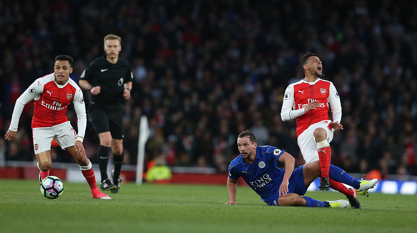Arsenal's Francis Coquelin ( right) is tackled by Leicester City's Daniel Drinkwater <br /> <br /> Photographer Stephen White/CameraSport<br /> <br /> The Premier League - Arsenal v Leicester City - Wednesday 26th April 2017 - Emirates Stadium - London<br /> <br /> World Copyright &copy; 2017 CameraSport. All rights reserved. 43 Linden Ave. Countesthorpe. Leicester. England. LE8 5PG - Tel: +44 (0) 116 277 4147 - admin@camerasport.com - www.camerasport.com
