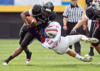 1129101135jlw  4A2foot1205 Williams's field's Alex Howard is tackled by Thunderbird High School's Troy Custer  during the 4AII State Championship at Sun Devil Stadium. (Pat Shannahan/ The Arizona Republic)