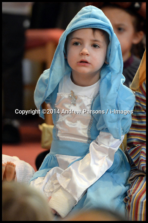 Image ©Licensed to i-Images Picture Agency. 16/12/2014. London. Yasmin and Isaac in their first Nativity play. Decmber 2014. Picture by Andrew Parsons / i-Images