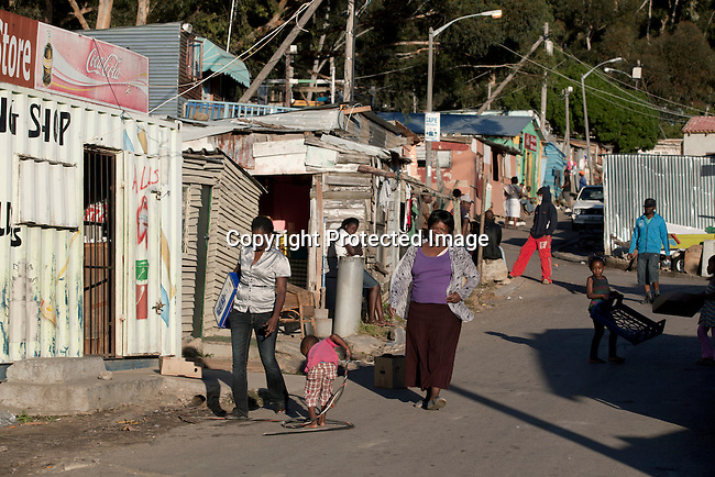CAPE TOWN, SOUTH AFRICA - APRIL 19: Veronica Daniels walks in her neighborhood in Imizamo Yethu, a poor township on April 19, 2011 in Hout Bay outside Cape Town, South Africa. (Photo by Per-Anders Pettersson)