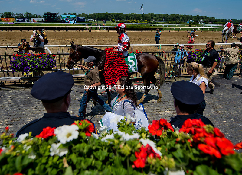 ELMONT, NY - JUNE 10: Songbird #5, ridden by Mike Smith, heads into the winner's circle after winning the Ogden Phipps Stakes on Belmont Stakes Day at Belmont Park on June 10, 2017 in Elmont, New York (Photo by Scott Serio/Eclipse Sportswire/Getty Images)