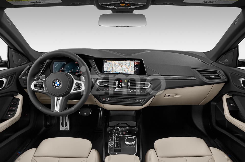 Stock photo of straight dashboard view of 2020 BMW 2-Series M-Sport 4 Door Sedan Dashboard