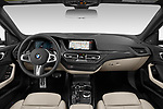 Stock photo of straight dashboard view of 2020 BMW 2-Series M-Sport 4 Door Sedan Dashboard