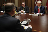 Polish President Andrzej Duda (L) US President Donald J. Trump (R) and US Secretary of State Mike Pompeo (C) during a luncheon in the cabinet room of the White House in Washington, DC, USA, 12 June 2019. Later in the day President Trump and President Duda will participate in a signing ceremony to increase military to military cooperation including the purchase of F-35 fighter jets and an increased US troop presence in Poland. <br /> Credit: Shawn Thew / Pool via CNP