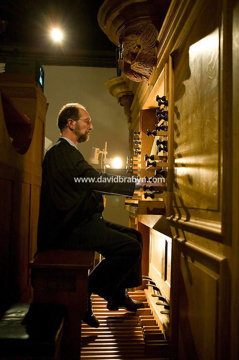 College Organist and Precentor, Jonathan Hellyer Jones performs during evensong at Magdalene College in Cambridge, United Kingdom, 11 March 2007.