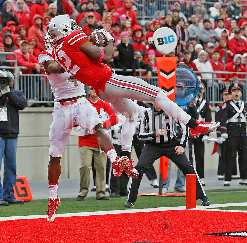 Ohio State Buckeyes cornerback Doran Grant (12) makes an interception in the end zone in the second quarter of their game at Ohio Stadium in Columbus, Ohio on October 18, 2014. (Columbus Dispatch photo by Brooke LaValley)