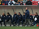 Bruce Arena (standing), head coach of the United States, paces in front of the bench during the first half on Sunday, February 19th, 2005 at Pizza Hut Park in Frisco, Texas. The United States Men's National Team defeated Guatemala 4-0 in a men's international friendly.