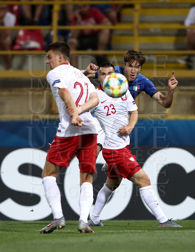 Football: Uefa under 21 Championship 2019, Italy -Poland, Renato Dall'Ara stadium Bologna Italy on June19, 2019.<br /> Italy's Federico Chiesa (r) in action with Poland's Konrad Michalak (c) and Karol Fila (r) during the Uefa under 21 Championship 2019 football match between Italy and Poland at Renato Dall'Ara stadium in Bologna, Italy on June19, 2019.<br /> UPDATE IMAGES PRESS/Isabella Bonotto