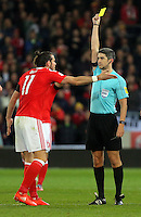 Gareth Bale of Wales sees a yellow card by match referee Alberto Mallenco during the 2018 FIFA World Cup Qualifier between Wales and Serbia at the Cardiff City Stadium, Wales, UK. Saturday 12 November 2016