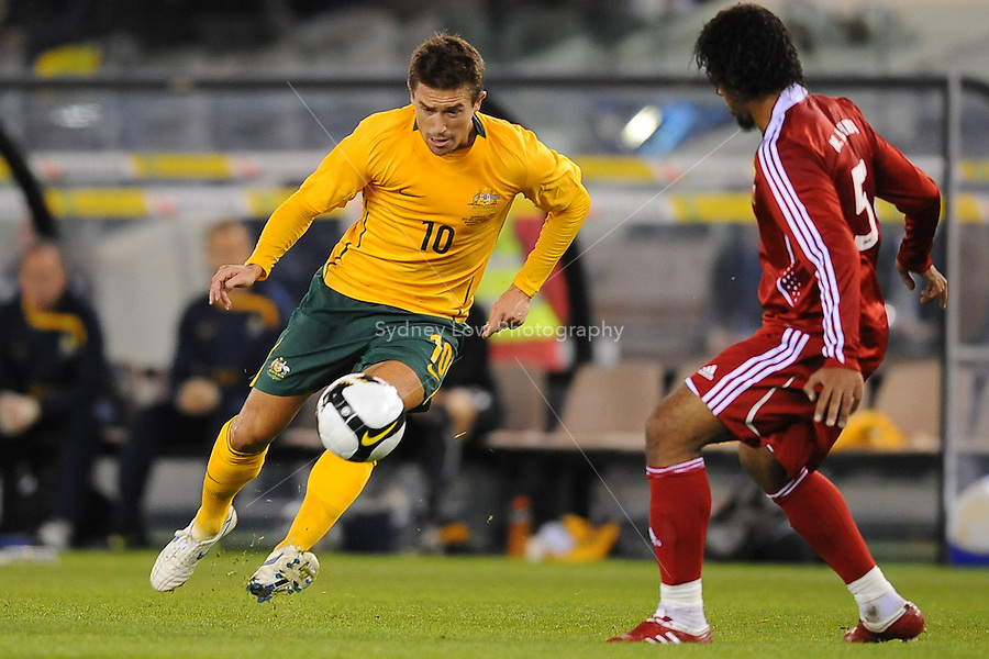 MELBOURNE, AUSTRALIA - OCTOBER 14: Harry Kewell from Australia contesting for the ball with Mohamed Al Balushi from Oman in a AFC Asian Cup 2011 match between Australia and Oman at Etihad Stadium on October 14, 2009 in Melbourne, Australia. Photo Sydney Low www.syd-low.com