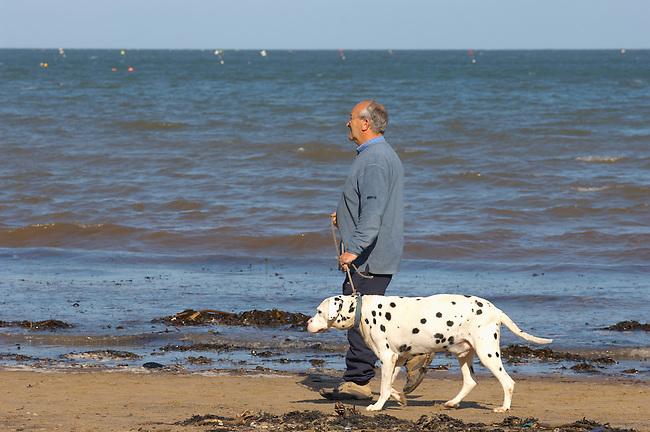 Runswick Bay - North Yorkshire - England - man walking dog