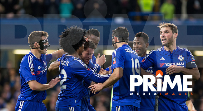 Players celebrate with goal scorer Eden Hazard of Chelsea during the FA Cup 5th round match between Chelsea and Manchester City at Stamford Bridge, London, England on 21 February 2016. Photo by Andy Rowland.
