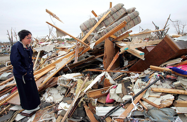 Linda Lavery looks at the remains of her house for the first time Tuesday morning, May 27, 2008 in Parkersburg. She and her husband were out of town when Sunday evening's EF5 tornado wiped out 400 homes in Parkersburg, claiming six lives.