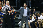 CHARLOTTESVILLE, VA - MARCH 03: Notre Dame head coach Mike Brey (right) complains to official Tim Comer (left). The University of Virginia Cavaliers hosted the University of Notre Dame Fighting Irish on March 3, 2018 at John Paul Jones Arena in Charlottesville, VA in a Division I men's college basketball game. Virginia won the game 62-57.