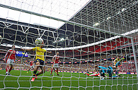 Callum O'Dowda (right) of Oxford United scores the opening goal with a header past goalkeeper Adam Davies of Barnsley during the Johnstone's Paint Trophy Final match between Oxford United and Barnsley at Wembley Stadium, London, England on 3 April 2016. Photo by Alan  Stanford / PRiME Media Images.