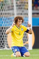 David Luiz of Brazil looks dejected as he prays