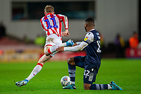 11th January 2020; Bet365 Stadium, Stoke, Staffordshire, England; English Championship Football, Stoke City versus Milwall FC; Mahlon Romeo of Millwall misses a tackle on James McClean of Stoke City - Strictly Editorial Use Only. No use with unauthorized audio, video, data, fixture lists, club/league logos or 'live' services. Online in-match use limited to 120 images, no video emulation. No use in betting, games or single club/league/player publications