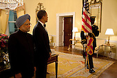 Washington, DC - November 24, 2009 -- United States President Barack Obama and Prime Minsiter Manmohan Singh wait to follow the Honor Guard from the Yellow Oval Room in the White House at the State Dinner, November 24, 2009. .Mandatory Credit: Pete Souza - White House via CNP