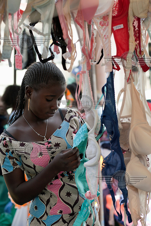 Women browse the second hand bras at the weekly market in Senegal. Bras are in particular high demand in Senegal as the item of clothing that traders can get the most money for and Oxfam are launching a campaign, The Big Bra Hunt to encourage more people in the UK to donate to their shops.