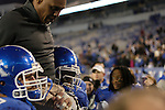 Coach Joker Phillips gets carried off the field by players after the UK Football game v. Samford at Commonwealth Stadium in Lexington, Ky., on Saturday, November 17, 2012. Photo by Genevieve Adams | Staff