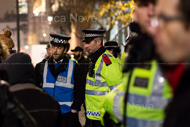 Day I - 21.11.2014 - &quot;Learn, Discuss, Participate&quot;.<br /> <br /> London 21-23/11/2014. First day of &quot;Return to Parliament Square&quot; at the Occupy Democracy Camp in London. This evening, protesters gathered in Parliament Square to have a 3-day-long re-occupation of the iconic London's landmark to &quot;Learn, Discuss, Participate&quot;. However, the famous grass outside the Houses of Parliament was patrolled by heavy police presence, supported by their dog's unit, deployed in the square and around the fences previously erected to surround and protect the square. After an attempt to occupy the &quot;patch of grass outside 10 Downing Street&quot;, the peaceful protest ended outside the Supreme Court of the United Kingdom where activists set up their new occupation camp. <br /> <br /> For more information please click here: http://occupydemocracy.org.uk/ &amp; http://on.fb.me/12tuv79<br />   <br /> For more photos and information about the previous Occupation please click here: http://bit.ly/1yOPtIc