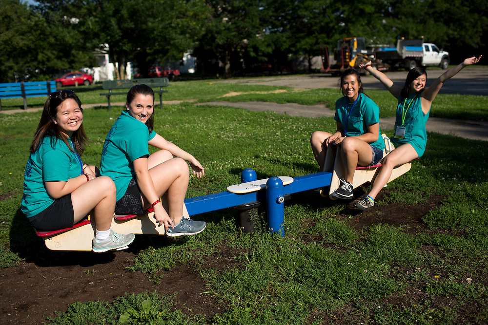 "Members ride a seesaw during ""Circle the City with Service,"" the Kiwanis Circle K International's 2015 Large Scale Service Project, on Wednesday, June 24, 2015, in the Hawthorne neighborhood in Indianapolis. (Photo by James Brosher)"