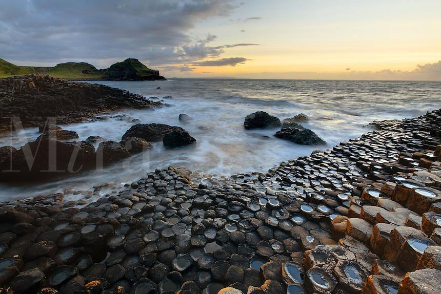 Waves splashing over basalt columns near sunset, Giant's Causeway, County Antrim, Northern Ireland, United Kingdon