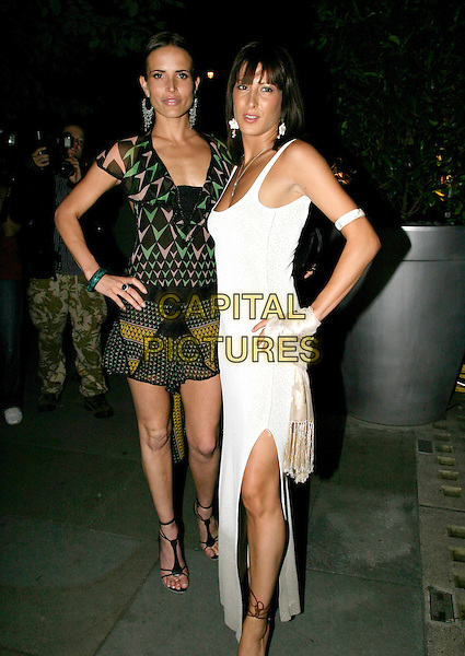 SOPHIE ANDERTON & GUEST.Rocawear: An Audience with Jay-Z aftershow party at St Martin's Cave Hotel..September 5th, 2005.full length posing white dress green black pattern print sheer dress hands on hips.www.capitalpictures.com.sales@capitalpictures.com.© Capital Pictures.