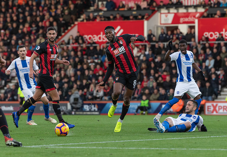 Bournemouth's Jefferson Lerma (center) is tackled by Brighton & Hove Albion's Florin Andone (right) <br /> <br /> Photographer David Horton/CameraSport<br /> <br /> The Premier League - Bournemouth v Brighton and Hove Albion - Saturday 22nd December 2018 - Vitality Stadium - Bournemouth<br /> <br /> World Copyright © 2018 CameraSport. All rights reserved. 43 Linden Ave. Countesthorpe. Leicester. England. LE8 5PG - Tel: +44 (0) 116 277 4147 - admin@camerasport.com - www.camerasport.com