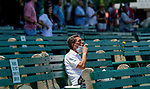 July 18, 2020: A man smokes a cigar on Haskell Invitational Day at Monmouth Park Racecourse in Oceanport, New Jersey. Scott Serio/Eclipse Sportswire/CSM