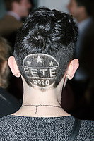 "Genevieve Coursey, a campaign volunteer from South Windsor, Conn., is seen with ""Pete 2020"" shaved into the back of her hair, after Democratic presidential candidate Pete Buttigieg spoke at a campaign event at the Currier Museum of Art in Manchester, New Hampshire, USA, on Fri., Apr. 5, 2019. The venue was filled to capacity about an hour before the candidate's arrival, so Buttigieg delivered an impromptu speech to those denied entry outside the museum before the official event. Buttigieg is the mayor of South Bend, Indiana, and was widely considered a long-shot candidate until his appearance in a CNN town hall in March 2019 which catapulted his campaign to prominence and substantial donations. <br /> <br /> Coursey says of the haircut, ""It was a crazy idea...Luckily it's a short name."" She had a Sam Flynt of the West Main Barbershop in Vernon, Conn., shave the design the day before. Coursey says she started supporting Buttigieg about a month and a half earlier. """"He's such a different candidate. I kind of fell for him. I wanted to vote for a woman. I'm all in for Pete!"""