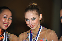 (L)  Aliya Garaeva of Azerbaijan and (Center) Daria Kondakova of Russia celebrate medals in Event Finals at 2011 Holon Grand Prix, Israel on March 5, 2011.  (Photo by Tom Theobald).