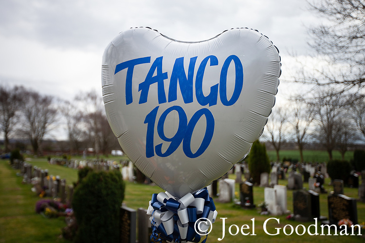 © Joel Goodman - 07973 332324 . 17/03/2012 . Staffordshire , UK . A balloon with PC Rathband's callsign - Tango 190 - left at the graveside . The funeral of former police officer David Rathband , at Stafford Crematorium . Rathband was found dead at his home in Blyth on 29th February 2012 . He was shot and blinded by killer Raoul Moat whilst he was on duty in the early hours of 4th July 2010 and went on to campaign for the Blue Lamp Foundation , which supports emergency staff injured in the line of duty , but he was reported to have never overcome the psychological impact of his injuries . Photo credit : Joel Goodman